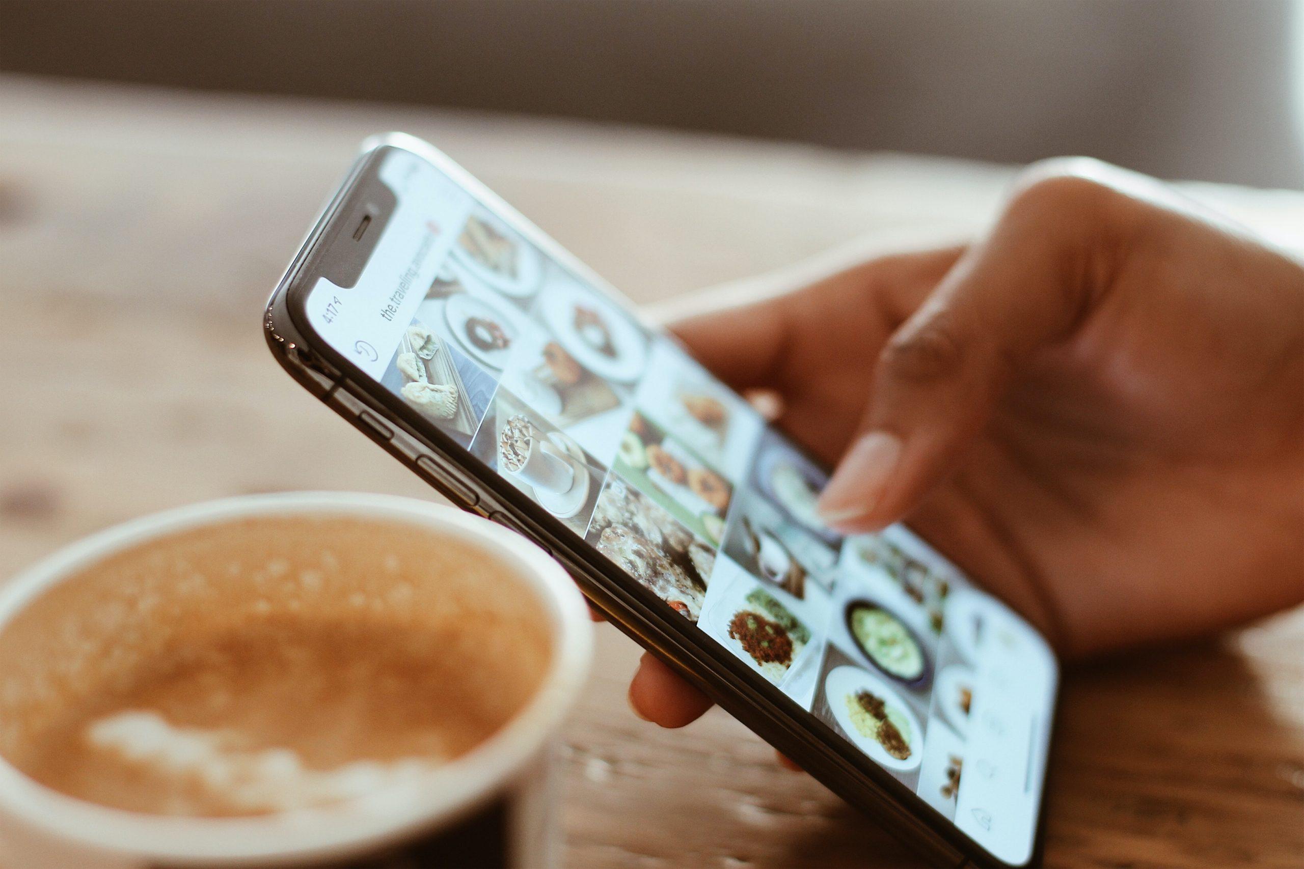 man using social media on iphone